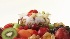 Assorted fruit and muesli with yoghurt, honey and berries Stock Footage