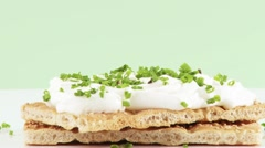 Soft cheese and chives on crispbread Stock Footage