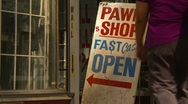 Stock Video Footage of woman walks into pawn shop, partial zoom back