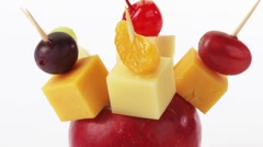 Cheese, fruit and olives on cocktail sticks Stock Footage