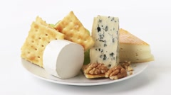 Cheese plate with crackers, grapes and walnuts - stock footage