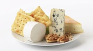 Cheese plate with crackers, grapes and walnuts Stock Footage