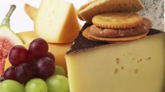Various cheeses with savoury biscuits and grapes Stock Footage