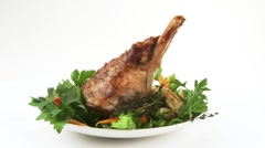 Roast lamb shank with herbs and vegetables Stock Footage