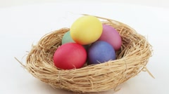 Coloured eggs in Easter nest Stock Footage