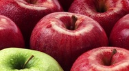 Stock Video Footage of Red apples and one green apple