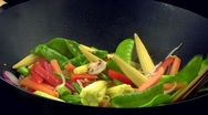 Stir-frying vegetables in a wok Stock Footage
