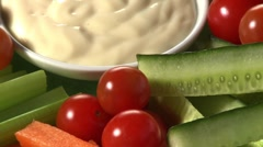 Platter of raw vegetables with dip Stock Footage