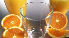 Pouring orange juice into a glass Stock Footage