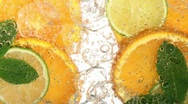 Stock Video Footage of Drink with citrus fruit (detail)
