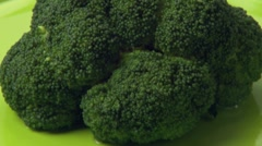 Pouring cheese sauce over broccoli - stock footage