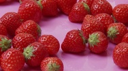 Stock Video Footage of Fresh strawberries with cream rosettes on pink plate