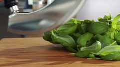 Chopping basil leaves with a mezzaluna Stock Footage