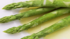 Green asparagus with melted butter and salt - stock footage