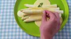 White asparagus with Hollandaise sauce Stock Footage