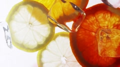 Making punch: pouring red wine onto citrus fruit - stock footage