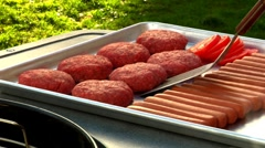 Burgers and sausages ready for grilling Stock Footage