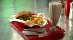Burger with chips and chocolate shake Stock Footage