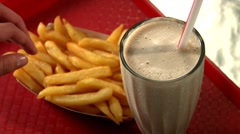Dipping chips in milkshake Stock Footage