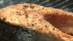 Salmon steaks on a barbecue Stock Footage