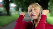Cheering woman outdoors Stock Footage
