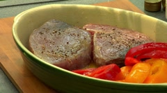 Seasoning tuna steaks Stock Footage