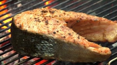 Brushing salmon steaks on a barbecue with marinade Stock Footage