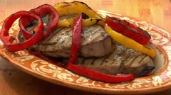 Grilled tuna steaks with pepper slices Stock Footage