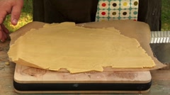 Lining a tart tin with shortcrust pastry Stock Footage
