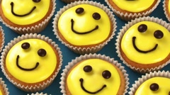Cupcakes with happy faces Stock Footage