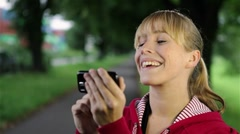 happy woman with smartphone outdoors - stock footage