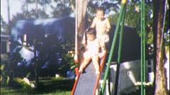 KIds Fun on Slide PLAYGROUND 1960s (Vintage Film Home Movie 355 Stock Footage