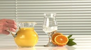 Stock Video Footage of Pouring a glass of orange juice