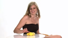 Blond woman biting into a lemon Stock Footage