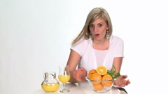 Blond woman holding a glass bowl of oranges Stock Footage