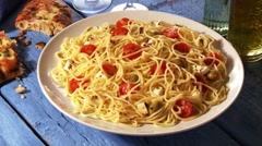 Spaghetti with tomatoes, mozzarella and olives Stock Footage