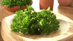 Chopping fresh parsley with a mezzaluna Stock Footage
