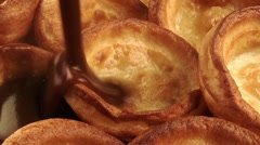 Pouring gravy over Yorkshire puddings Stock Footage