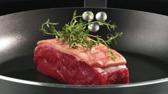 Beef sirloin in a frying pan Stock Footage