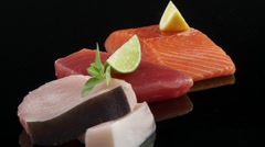 Salmon fillet, tuna steak and swordfish steak Stock Footage