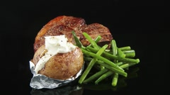 Fried T-bone steak with green beans and baked potato Stock Footage
