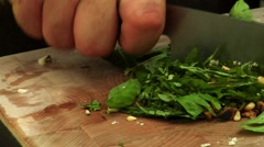 Chopping basil and pine nuts (for pesto) Stock Footage