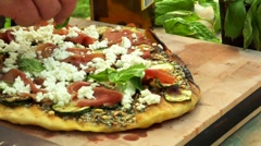 Putting basil leaves on a pizza Stock Footage