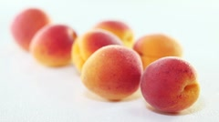 Spraying fresh apricots with water Stock Footage