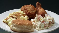 Deep-fried chicken pieces with coleslaw and potato salad Stock Footage