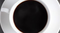 A cup of coffee (from above) Stock Footage