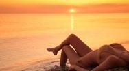 Beautiful woman in  bikini on the beach at sunset Stock Footage