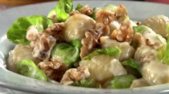 Pasta shells with Brussels sprouts, walnuts and Parmesan Stock Footage