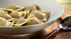 Plating mushroom ravioli with tomato sauce - stock footage