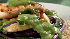 Chicken breast with green sauce and beetroot on brown rice Stock Footage